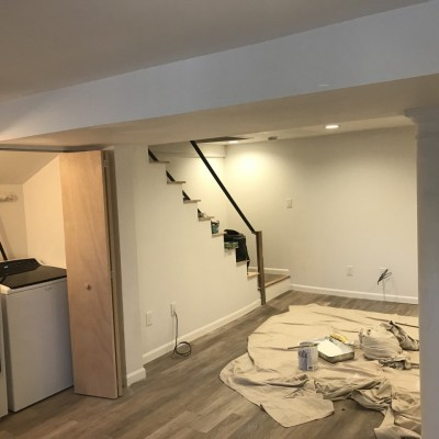 new basement renovation with stairs and utilities