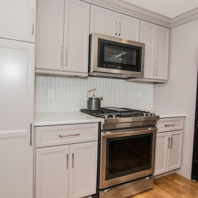 ful kitchen remodel with stove and oven
